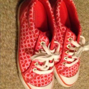 Women's coach tennis shoes size 6B. Pink
